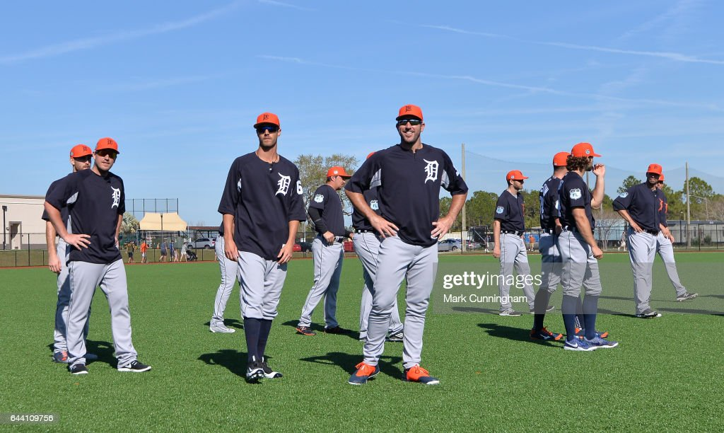 Jordan Zimmermann #27, Shane Greene #61 and Justin Verlander #35 of the Detroit Tigers stand together with teammates on the field during Spring Training workouts at the TigerTown facility on February 20, 2017 in Lakeland, Florida.