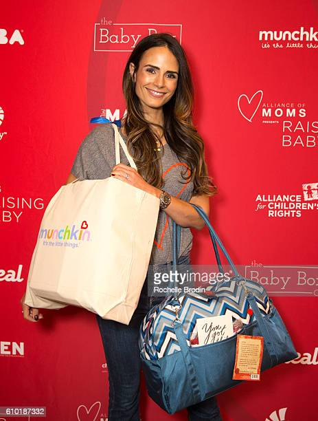 Jordana Brewster models the Munchkin gift bag and the Red Hens Studio diaper bag at the Alliance of Moms Raising Baby event at the Children's...
