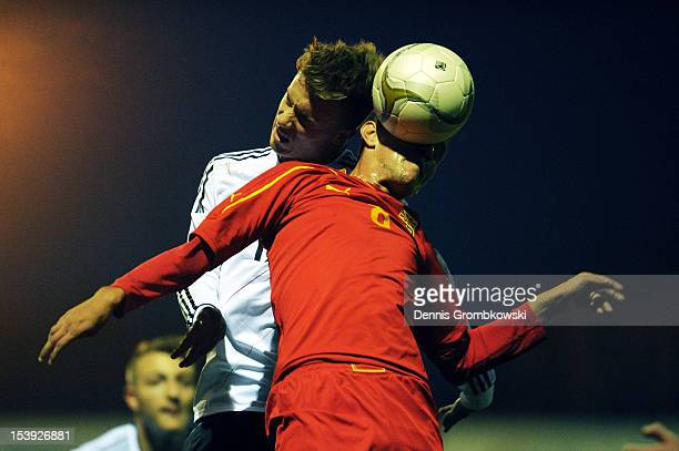 Jordancho Naumoski of Macedonia and Yannick Gerhardt of Germany jump for a header during the Under 19 EURO qualification match between U19 Macedonia...