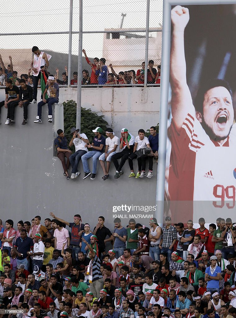 Jordanese fans watch their national team play their 2014 World Cup qualifier football match against Uzbekistan at the King Abdullah international stadium in Amman on September 6, 2012. The match ended in a draw.