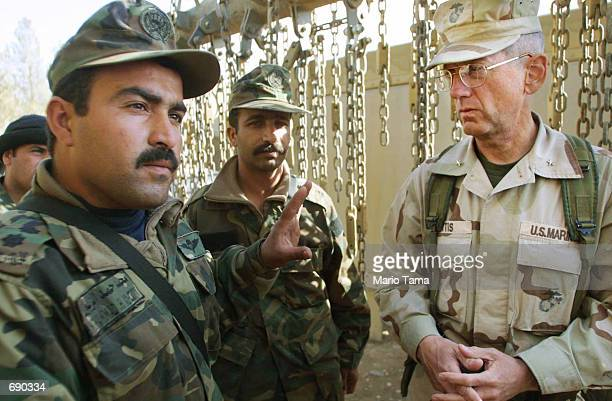 Jordanian Army Lt Mohammed AlZboun meets with United States Marine General James N Mattis on the American military compound at Kandahar Airport...