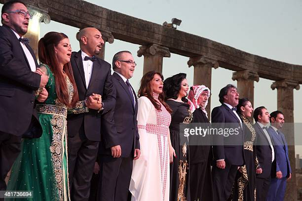 Jordanian artists perform on stage during the opening of the 30th Jarash Festival of Culture and Arts in the ancient Roman city of Jarash 50...