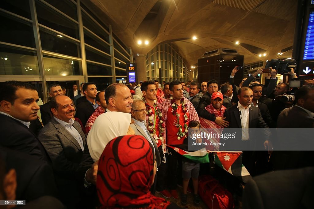 Jordanian athlete Ahmad Abughaush, who won gold medal in Men's 68 kg Taekwondo in Rio 2016 Olympic Games, poses with his family after he returned from Rio De Janeiro at Queen Alia International Airport in Amman's Zizya district, Jordan on August 24, 2016.