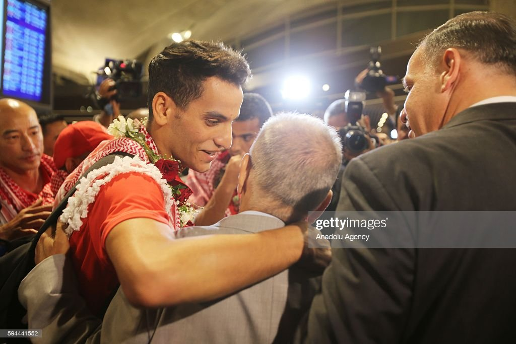 Jordanian athlete Ahmad Abughaush (2nd L), who won gold medal in Men's 68 kg Taekwondo in Rio 2016 Olympic Games, is welcomed by his family and his supporters at Queen Alia International Airport in Amman's Zizya district, Jordan on August 24, 2016.