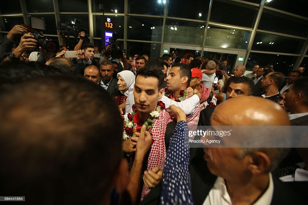 Jordanian athlete Ahmad Abughaush (C), who won gold medal in Men's 68 kg Taekwondo in Rio 2016 Olympic Games, is welcomed by his family and his supporters at Queen Alia International Airport in Amman's Zizya district, Jordan on August 24, 2016.