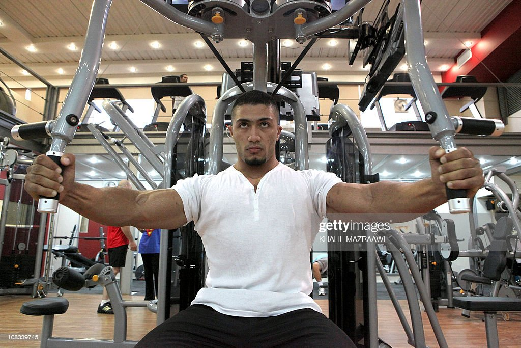 STORY -- Jordanian bodybuilding world champion Zaid al-Far is pictured at a gym in Amman on October 23, 2010. Far came first in the Men's Wold Championship in 2010. AFP PHOTO/KHALIL MAZRAAWI
