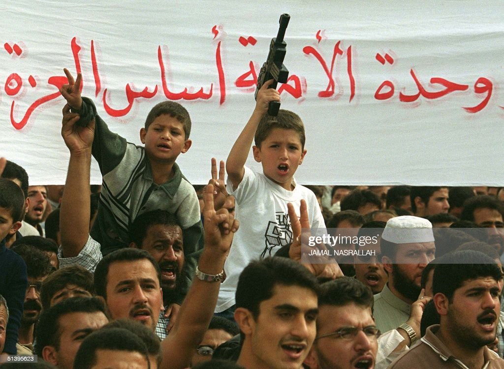 Jordanian children one carrying a toy gun join a Muslim Brotherhoodled proPalestinian demonstration of some 3000 people in Amman 20 October 2000 on...