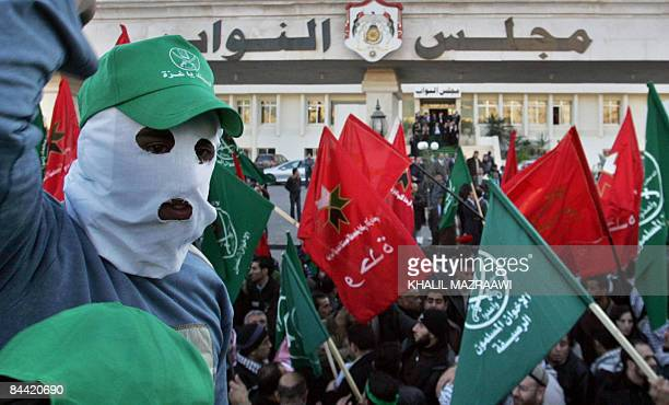 Jordanian demonstrators waving green Muslim Brotherhood flags and other banners shout antiIsrael slogans during a mass rally held outside the...