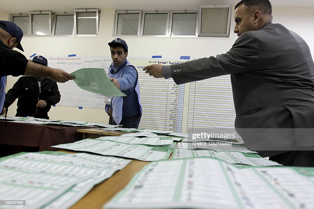 Jordanian election officials start counting votes in Amman on January 23, 2013. Jordanians turned out in numbers for polls snubbed by Islamists who alleged vote buying and shed doubt on turnout figures, slamming as illegitimate what is likely to be an opposition-free body.