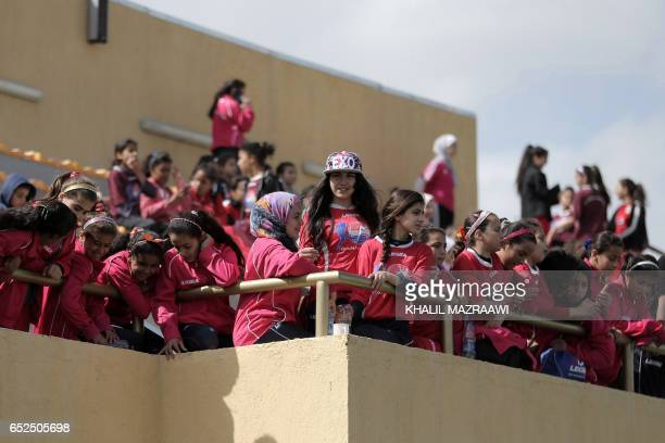 Jordanian female fans attend an exhibition game in celebration of International Women's Day in Amman on March 11 as part of an event organized by...