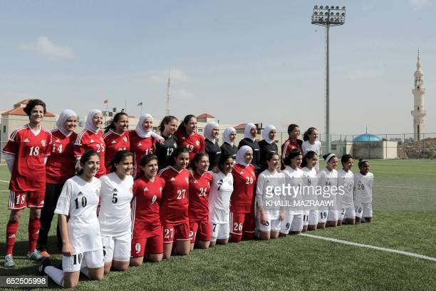 Jordanian female footballers pose for a group picture during an exhibition game in celebration of International Women's Day in Amman on March 11 as...