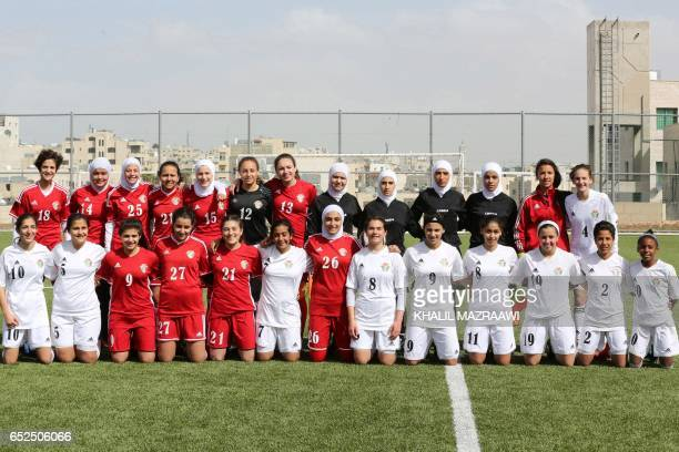 Jordanian female footballers pose for a group picture following an exhibition game in celebration of International Women's Day in Amman on March 11...