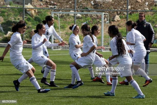 Jordanian female footballers take part in a practice session in celebration of International Women's Day in Amman on March 11 as part of an event...