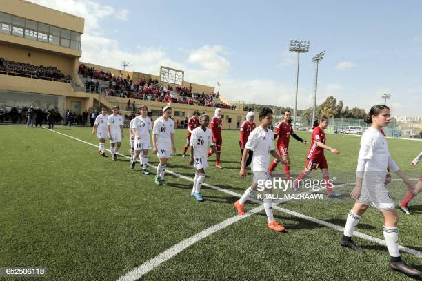 Jordanian female footballers take part in an exhibition game in celebration of International Women's Day in Amman on March 11 as part of an event...
