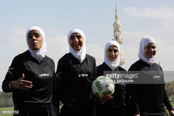 Jordanian female match officials take part in an exhibition game in celebration of International Women's Day in Amman on March 11 as part of an event...