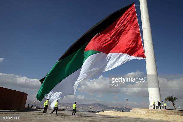 Jordanian flag is raised during a ceremony marking the 100th anniversary of the Great Arab Revolt against the regions ruling Ottoman Turks January 23...