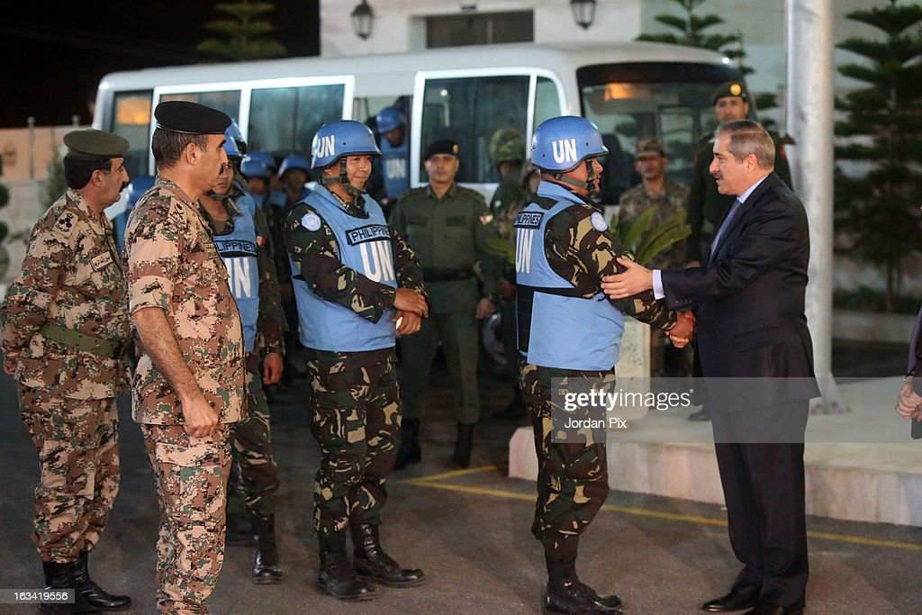 Jordanian Foreign minister Nasser Joudah greets the twenty-one Filipino UN peacekeepers who were held hostage at the free Syrian army in Golan as they arrive in Amman after crossing into Jordan from Syria on March 9, 2013 in Amman, Jordan. The hostages were received by the Jordanian Foreign minister Nasser Joudah, Minister of Information Samih Maaytah and the Chief of Staff Mishaal al Zaben.