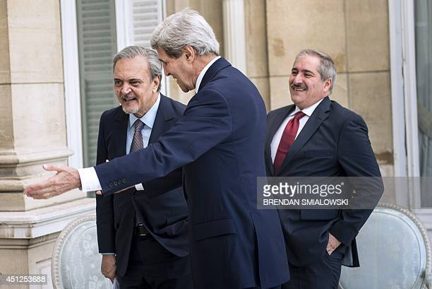 Jordanian Foreign Minister Nasser Judeh and US Secretary of State John Kerry and Saudi Arabia's Foreign Minister Prince Saud alFaisal walk to a...