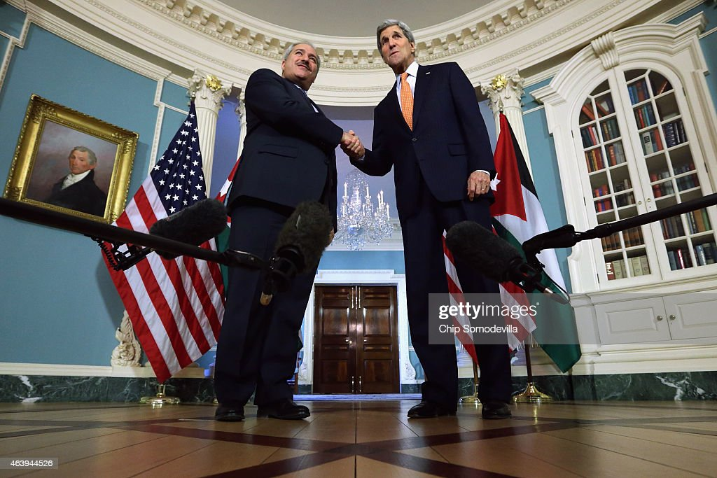 Jordanian Foreign Minister Nasser Judeh (L) and U.S. Secretary of State John Kerry shake hands after making brief remarks to members of the news media before meetings at the State Department February 20, 2015 in Washington, DC. Kerry and Judeh reiterated their common goals and shared military and diplomatic efforts to defeat the self-proclaimed Islamic State, or ISIS, in Iraq in Syria.