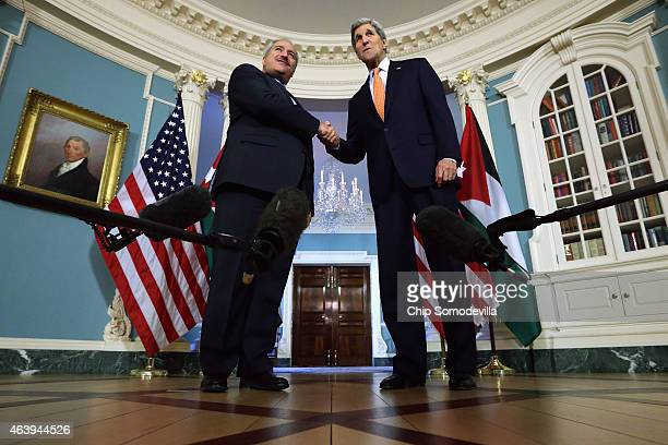 Jordanian Foreign Minister Nasser Judeh and US Secretary of State John Kerry shake hands after making brief remarks to members of the news media...