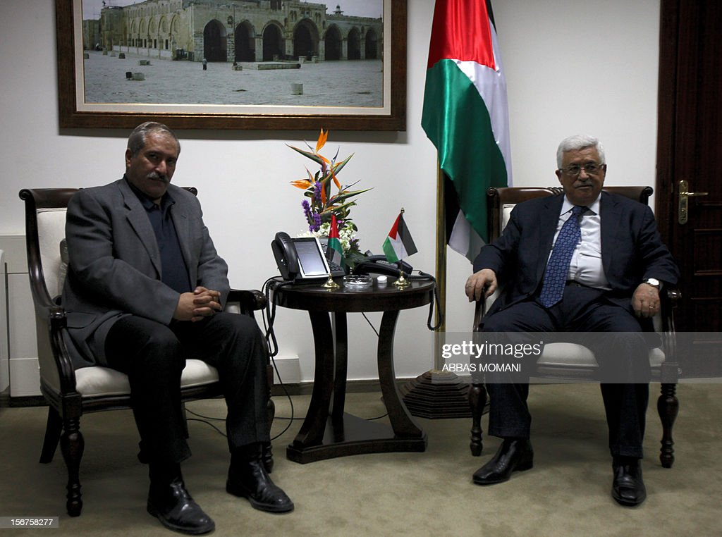 Jordanian Foreign Minister Nasser Judeh (L) meets with Palestinian president Mahmoud Abbas at the presidential headquarters in the West Bank city of Ramallah on November 20, 2012.