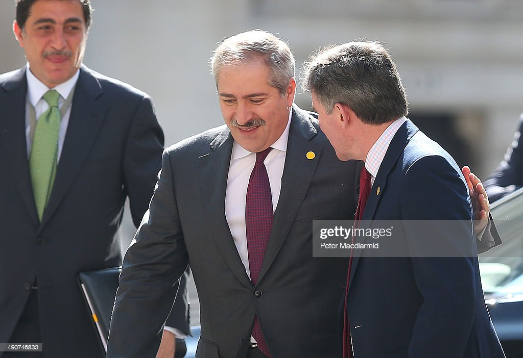 Jordanian Foreign Minister Nasser Judeh (C) puts his arm round British Minister of State Hugh Roberts (R) as he arrives at the Foreign and Commonwealth Office to attend a Friends Of Syria meeting on May 15, 2014 in London, England. Foreign ministers from Western and Arab nations are meeting to discuss ways of supporting the Syrian opposition.