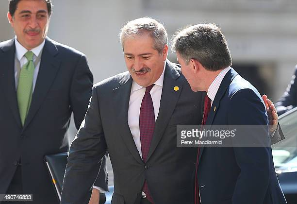 Jordanian Foreign Minister Nasser Judeh puts his arm round British Minister of State Hugh Roberts as he arrives at the Foreign and Commonwealth...
