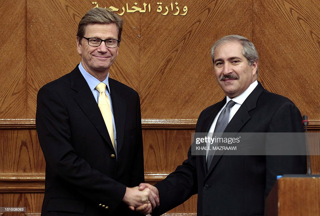 Jordanian Foreign Minister Nasser Judeh shakes hands with his German counterpart Guido Westerwelle (L) during a meeting in Amman on September 8, 2012.