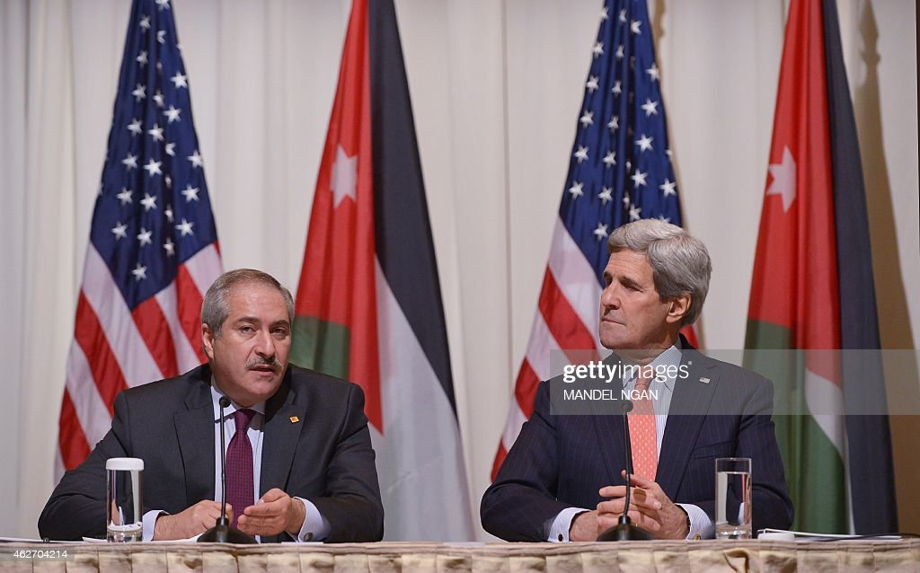 Jordanian Foreign Minister Nasser Judeh (L) speaks as US Secretary of State John Kerry looks on during a signing ceremony for a memorandum of understanding for US assistance to Jordan during a ceremony on February 3, 2015 at a hotel in Washington, DC.