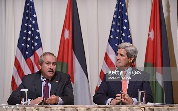 Jordanian Foreign Minister Nasser Judeh speaks as US Secretary of State John Kerry looks on during a signing ceremony for a memorandum of...