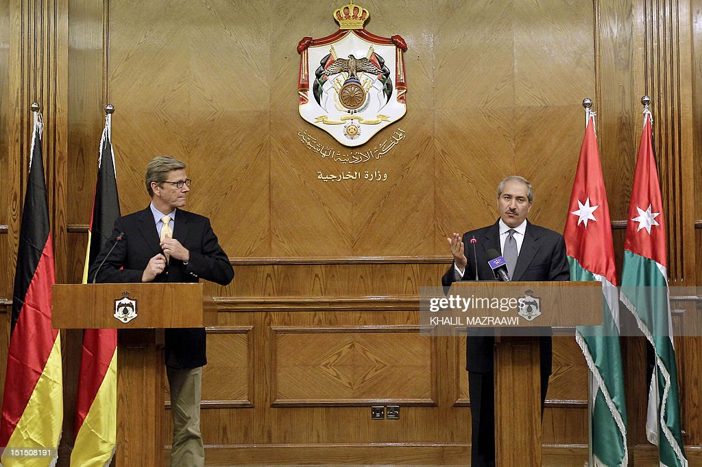 Jordanian Foreign Minister Nasser Judeh speaks during a joint press conference with his German counterpart Guido Westerwelle (L) following a meeting in Amman on September 8, 2012.