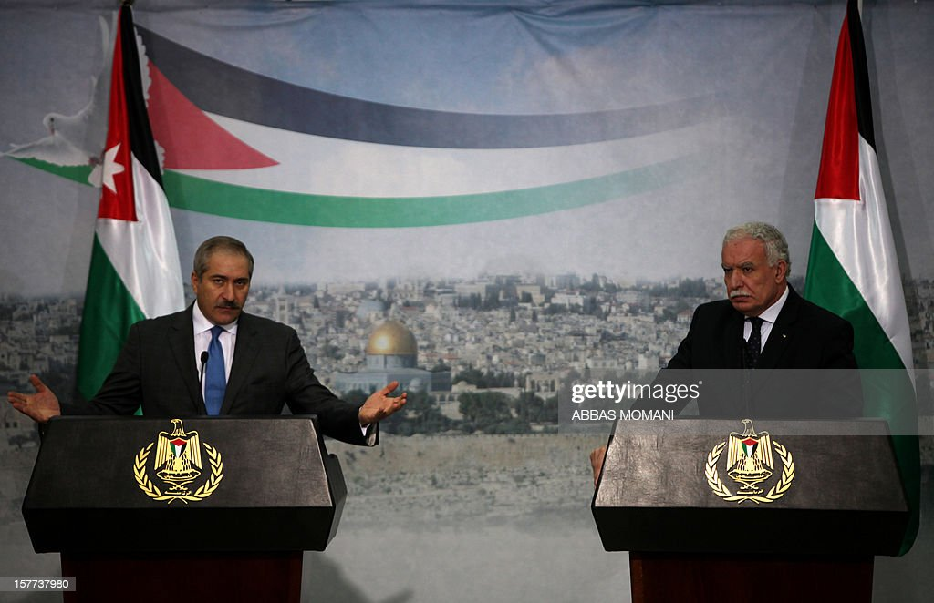 Jordanian Foreign Minister, Nasser Judeh (L), speaks during a joint press conference with his Palestinian counterpart Riyad al-Malki in the West Bank city of Ramallah on December 6, 2012. Judeh is accompanying Jordanian King Abdullah II on the first visit by a top foreign leader since the Palestinians gained upgraded United Nations status.
