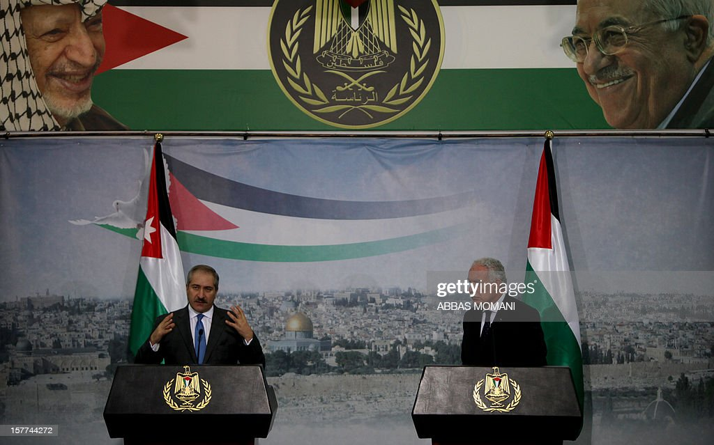 Jordanian Foreign Minister, Nasser Judeh (L), speaks during a joint press conference with his Palestinian counterpart Riyad al-Malki (R) under a poster of Palestinian president Mahmoud Abbas (top-R) and late Palestinian leader Yasser Arafat (top-L) in the West Bank city of Ramallah on December 6, 2012. Judeh is accompanying Jordanian King Abdullah II on the first visit by a top foreign leader since the Palestinians gained upgraded United Nations status.