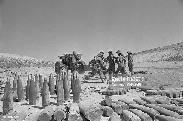 Jordanian gunners load artillery shell into an American 155 canon at their position near Amman during the Black September coup attempt on the...