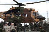 A Jordanian helicopter carrying French Foreign minister Laurent Fabius on board lands at the Mukataa compound in the West Bank city of Ramallah on...