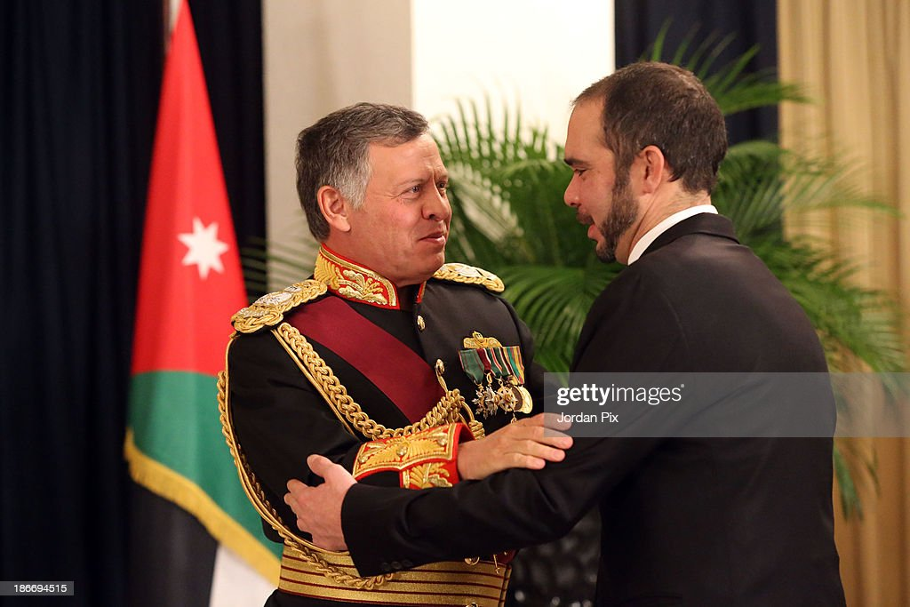 Jordanian King Abdullah II (L) is greeted by his brother <a gi-track='captionPersonalityLinkClicked' href=/galleries/search?phrase=Prince+Ali+Bin+Al+Hussein&family=editorial&specificpeople=160174 ng-click='$event.stopPropagation()'>Prince Ali Bin Al Hussein</a> during the throne opening ceremony of the first ordinary session of the 17th Parliament on November 3, 2013 in Amman, Jordan.