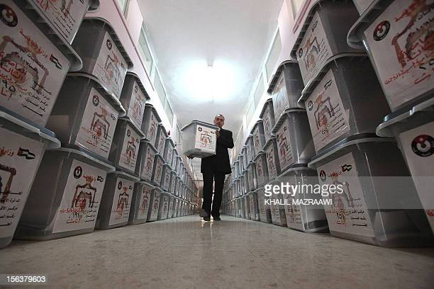 A Jordanian man carries a ballot box during preparations at the main electoral center in Amman on November 6 2010 for next week's parliamentary...