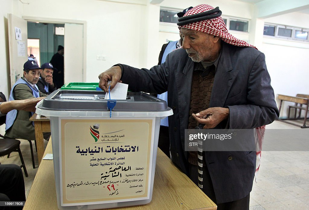 A Jordanian man casts his ballot at a polling station in Amman on January 23, 2013. Jordanians are voting in a parliamentary poll snubbed by Islamists who have staged strident pro-reform protests and who have already slammed what is expected to be an opposition-free body as illegitimate.