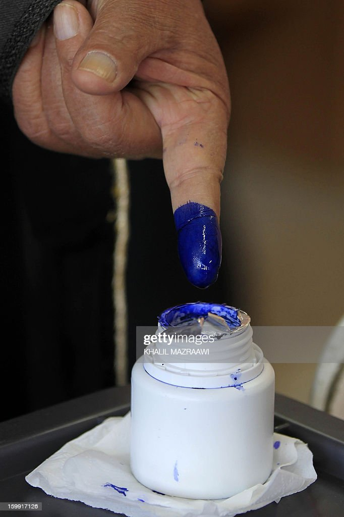 A Jordanian man dips his finger in ink after voting at a polling station in the Palestinian refugee camp of Baqaa, north of Amman, on January 23, 2013. Jordanians are voting in a parliamentary poll snubbed by Islamists who have staged strident pro-reform protests and who have already slammed what is expected to be an opposition-free body as illegitimate. AFP PHOTO/KHALIL MAZRAAWI