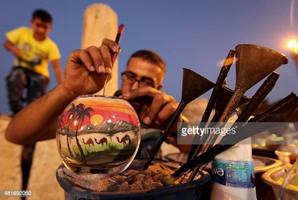 A Jordanian man makes sand art bottles during the opening of the 30th Jarash Festival of Culture and Arts in the ancient Roman city of Jarash 50...