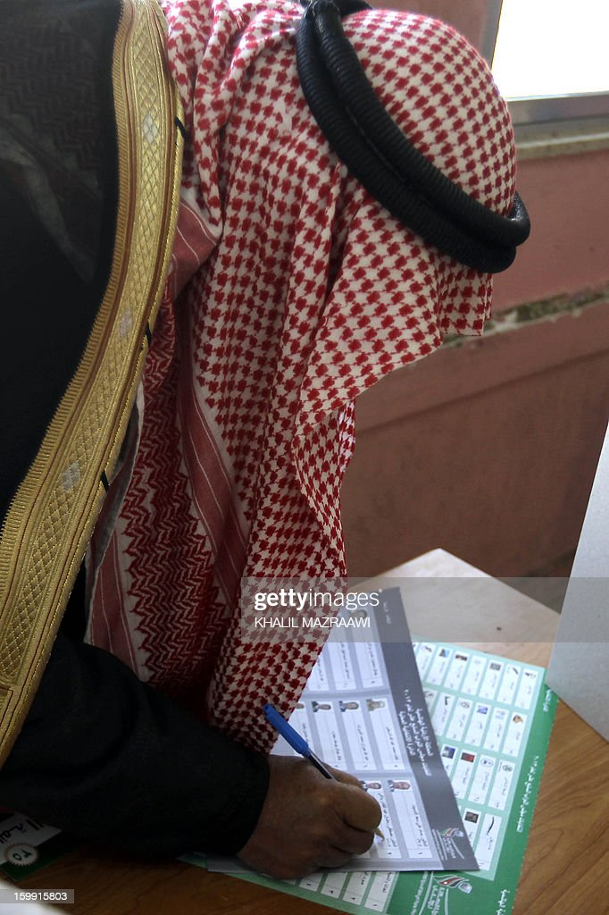 A Jordanian man marks his ballot at a polling station in the Palestinian refugee camp of Baqaa, north of Amman, on January 23, 2013. Jordanians are voting in a parliamentary poll snubbed by Islamists who have staged strident pro-reform protests and who have already slammed what is expected to be an opposition-free body as illegitimate. AFP PHOTO/KHALIL MAZRAAWI