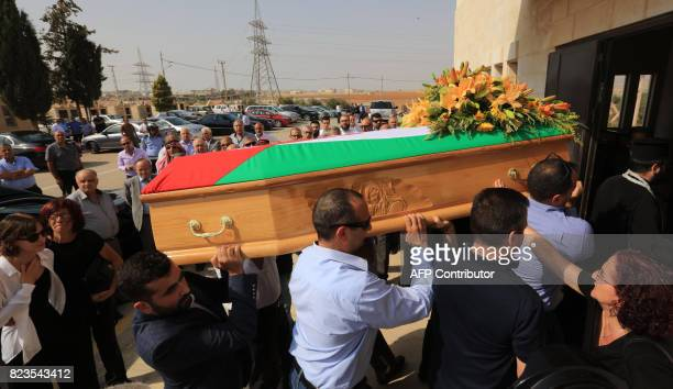 Jordanian mourners attend a funeral of Bashar Hamarneh a doctor who was in the residential quarter of the Israeli embassy at the time of an attack on...