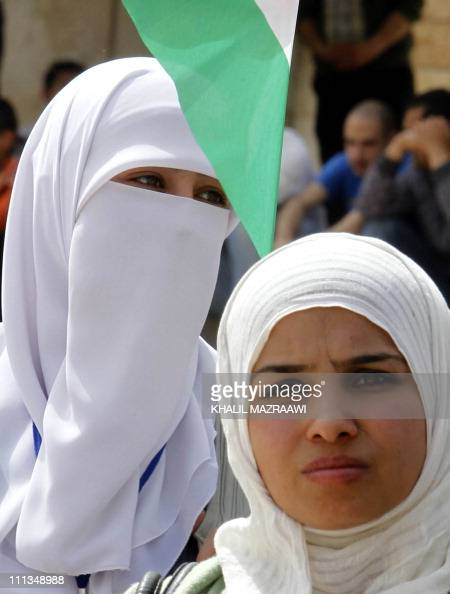 Jordanian Muslim women take part in demonstrations in the capital Amman on April 1 calling for reforms a week after clashes between them and...
