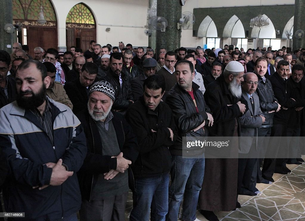 Jordanian Muslim worshippers perform a prayer on February 4 2015 in the capital Amman for Jordanian pilot Maaz alKassasbeh who was burnt alive by...
