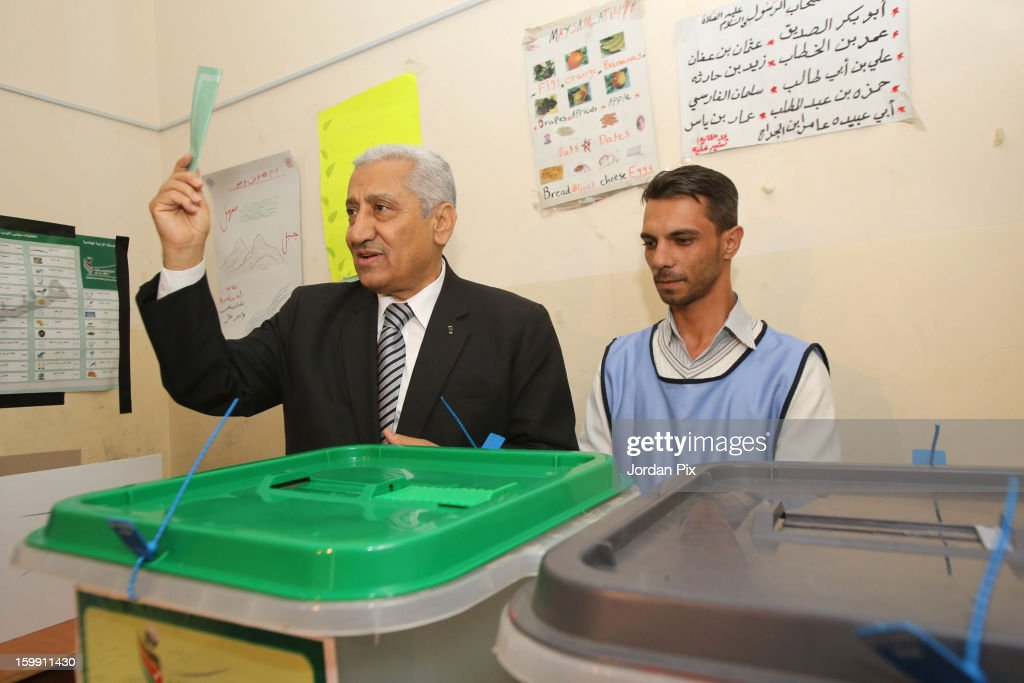 Jordanian Prime Minister Abdullah Al Nsour votes in the parliamentary elections on January 23, 2013 in Al Seru near Amman, Jordan. Jordan's election has come under criticism with claims that they are not democratic elections despite King Abdullah of Jordan's promise that the elections will see a popularly-elected candidate become prime minister for the first time.