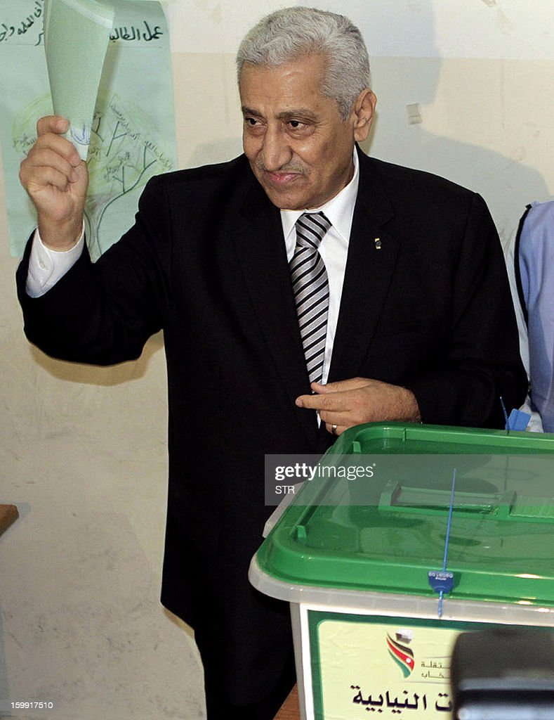 Jordanian Prime Minister Abdullah Nsur prepares to cast his ballot at a polling station in Salt, 20 kms northwest of Amman, on January 23, 2013. Jordanians are voting in a parliamentary poll snubbed by Islamists who have staged strident pro-reform protests and who have already slammed what is expected to be an opposition-free body as illegitimate. AFP PHOTO/STR