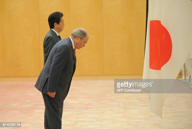 Jordanian Prime Minister Hani alMulki Japanese Prime Minister Shinzo Abe inspect an honor guard during a welcoming ceremony at the Prime Minister...