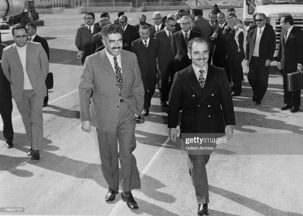 Jordanian Prime Minister Wasfi Al-Tal (1919 - 1971, left) accompanies <a gi-track='captionPersonalityLinkClicked' href=/galleries/search?phrase=King+Hussein&family=editorial&specificpeople=93663 ng-click='$event.stopPropagation()'>King Hussein</a> of Jordan (1935 - 1999), circa 1962.