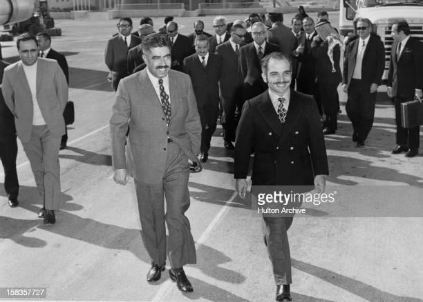 Jordanian Prime Minister Wasfi AlTal accompanies King Hussein of Jordan circa 1962