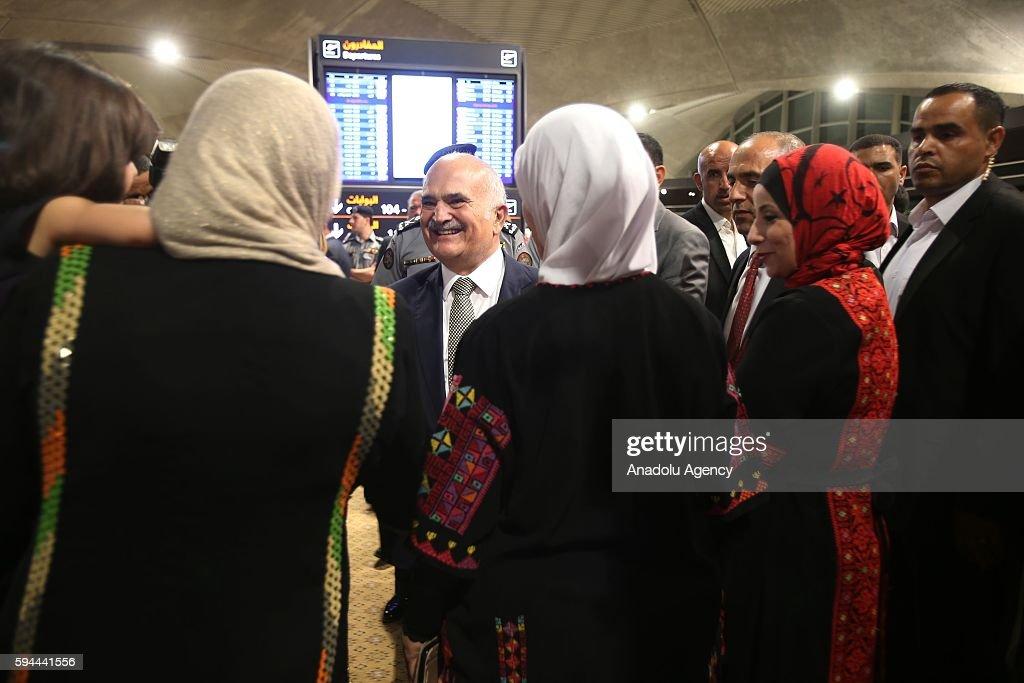 Jordanian Prince Hassan bin Talal (C) talks with family of Jordanian athlete Ahmad Abughaush (not seen), who won gold medal in Men's 68 kg Taekwondo in Rio 2016 Olympic Games, at Queen Alia International Airport in Amman's Zizya district, Jordan on August 24, 2016.